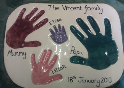 Family hand prints in a clay plaque