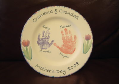Grandsons painted handprints on a plate for Grandma for Mother's Day