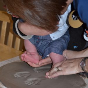 Baby hand and foot clay prints