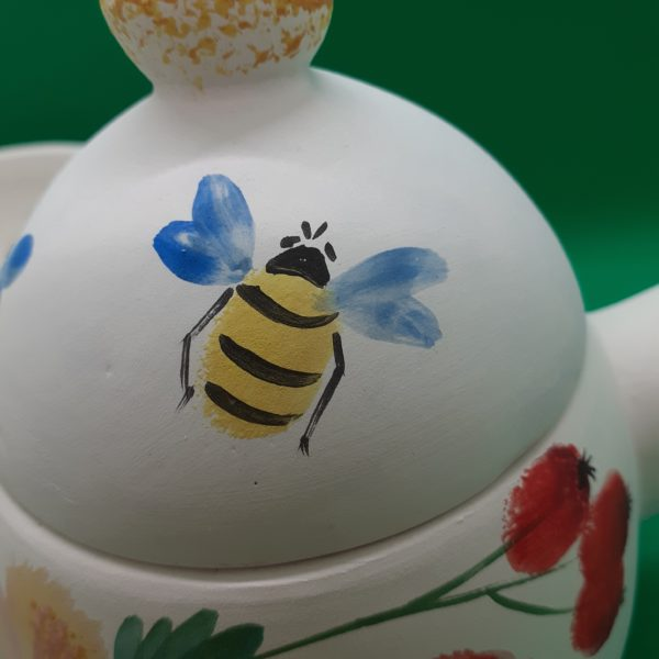 Bee on teapot
