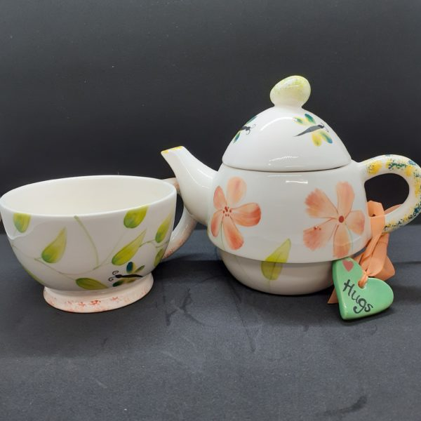 orange teapot and cup