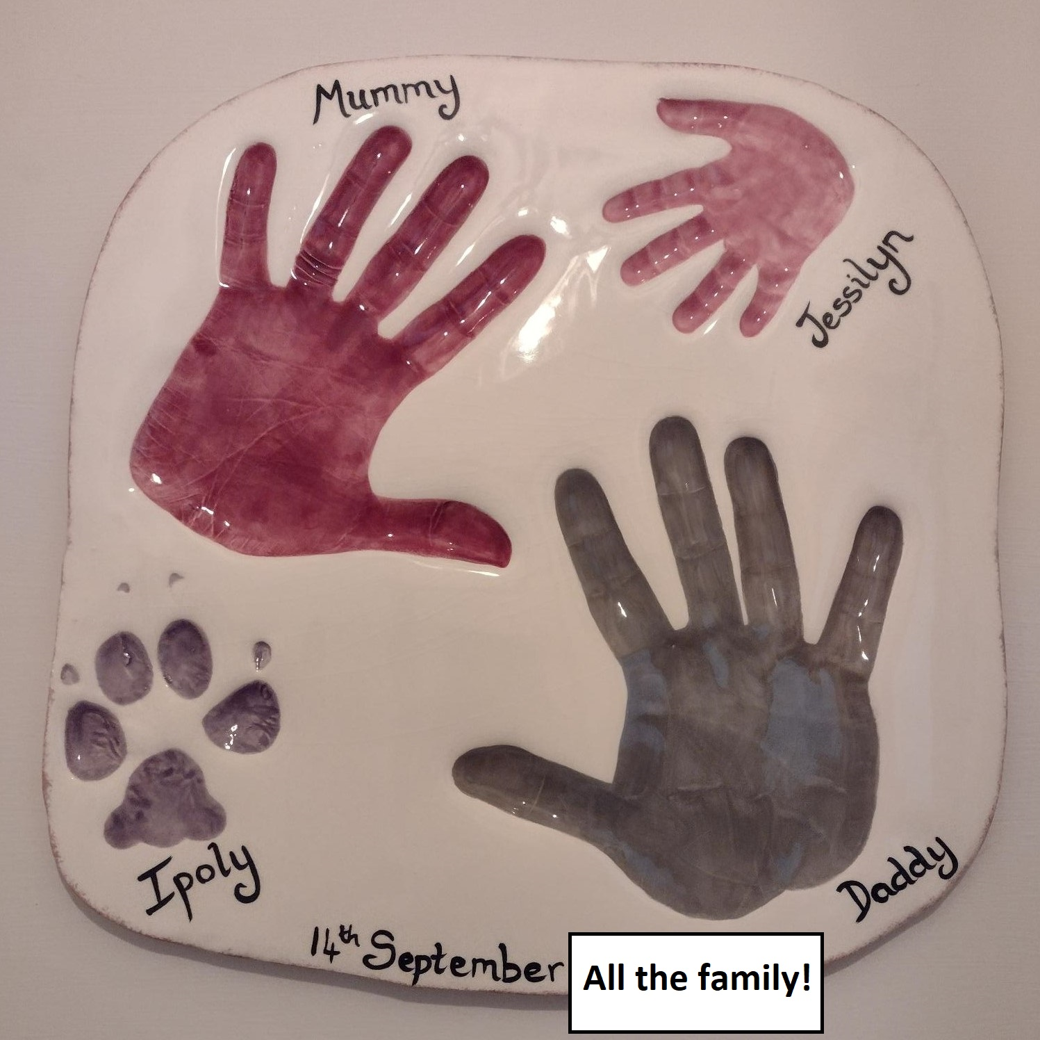 Family hand and paw prints
